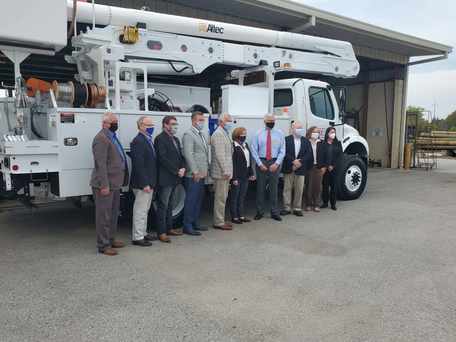 representatives of Tennessee Broadband Association members standing in front of a lift truck