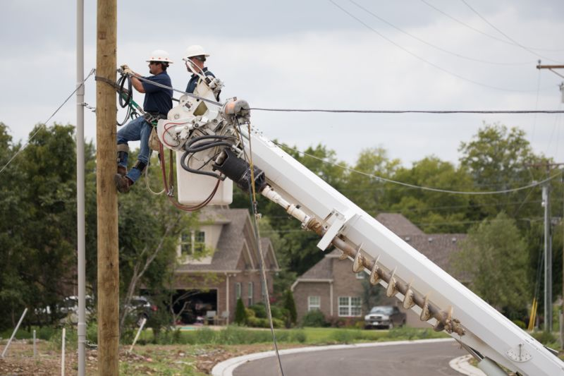 Nick Sircy, left, John Hale and other DTC Communications crew install fiber in a new neighborhood at 12 Corners on the outskirts of Murfreesboro.