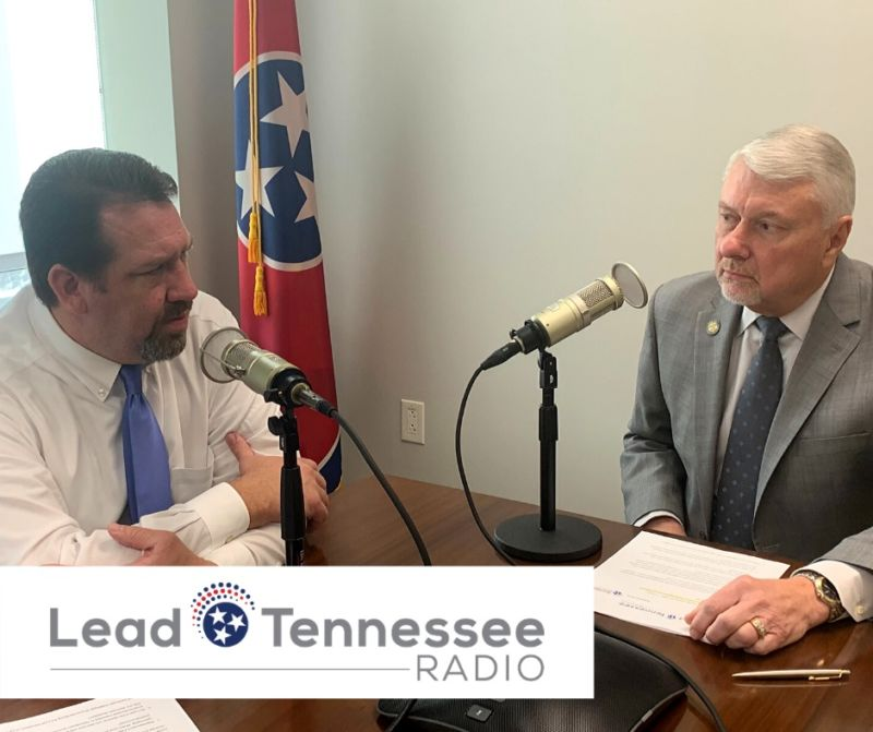 State Representative Jeremy Faison and Levoy Knowles sitting at a table recording a podcast