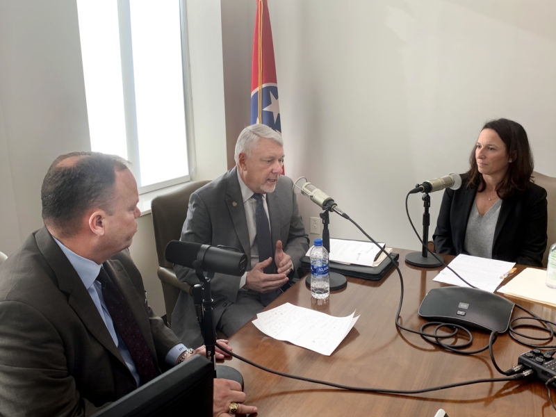 Steve Buttry, Levoy Knowles, and Kim Adkins sitting at a table recording a podcast