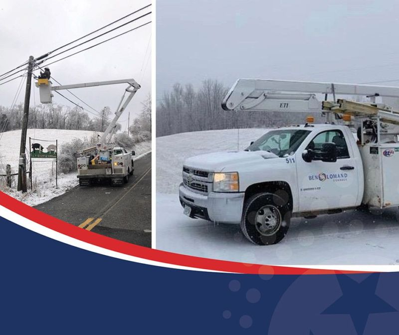 bucket truck in the snow working on power lines